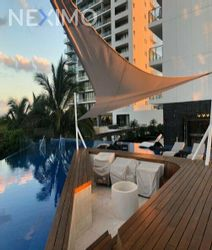 NEX-47190 - Departamento en Venta, con 1 recamara, con 1 baño, con 1 medio baño, con 122 m2 de construcción en Zona Hotelera, CP 77500, Quintana Roo.
